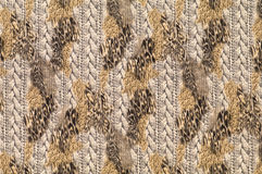 Textile with patterns of leopard and braids. Motley textile with patterns of leopard and braids Royalty Free Stock Photography