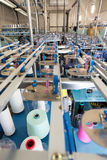 Textile production view. With colored yarn cones Stock Photo