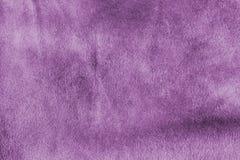 Purple textile texture. Textile purple background draped in waves Stock Photos