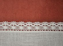Textile red brown and ivory white lace horizontal background with light gradient. Texture Royalty Free Stock Photos