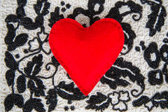 Textile red heart. On bead background handmade Royalty Free Stock Images