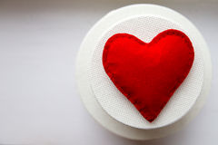 Textile red heart. Handmade on  gift boxes Stock Photos