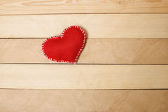 Textile red heart   on  wooden texture Royalty Free Stock Image