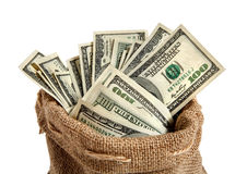 Textile sack with money. Studio photography of bag with hundred dollar bills stock photo