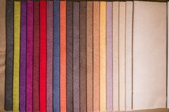 Textile samples of different colors for the selection of furniture upholstery royalty free stock photos
