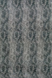 Textile with scale-like vertical texture of snake. Black and white textile background with scale-like vertical texture of snake Stock Photo