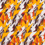 Textile seamless pattern of colored triangles in warm colors.  Royalty Free Stock Photos