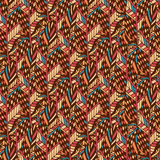 Textile seamless pattern in ethnic colors. Ethnic fabric texture in boho style Stock Images