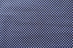 Textile with white dots on blue background Royalty Free Stock Image