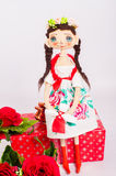 Textile souvenir doll in  costume Stock Photos