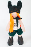 Textile souvenir doll in  costume Stock Image