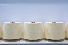 Textile spindles Stock Photos