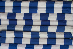 Textile striped covers for sunbeds, stacked on top of each other, background Royalty Free Stock Images