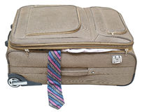 Textile suitcase with fell out tie isolated. On white background Royalty Free Stock Photos