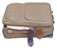 Textile suitcase with two fell out ties isolated. On white background Royalty Free Stock Photo