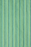 Textile texture. Green textile with colored strips Stock Image