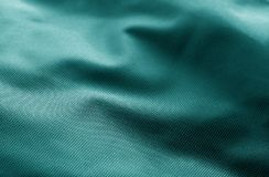 Textile texture with blur effect in cyan color. Abstract background and texture for design stock image