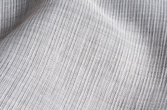 Textile texture. Close up of laid strong cloth, mixed gray textile on table Stock Photography