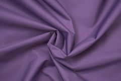 Silk crumpled fabric purple. View from above. royalty free stock image