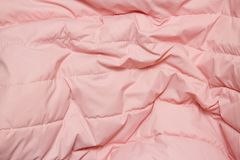 Textile and texture concept. Close up of pink fabric background royalty free stock photography