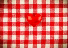 Textile texture in red and white cell with one red heart Royalty Free Stock Photos