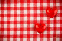 Textile texture in red and white cell with two red hearts Stock Images