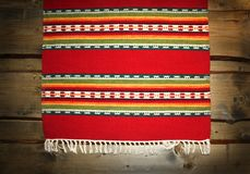 Textile traditional mat on wood backdrop Royalty Free Stock Image