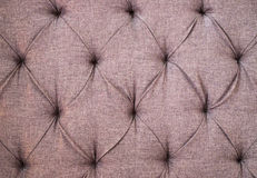 Textile upholstery with buttons Royalty Free Stock Image