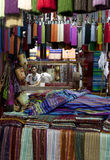 A textile weaver at work in the Fez medina, Morocco. Royalty Free Stock Images