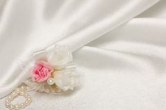 Textile wedding background with pearls Royalty Free Stock Image