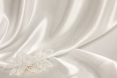 Textile wedding background with pearls Stock Images
