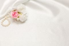 Textile wedding background with pearls Stock Photo