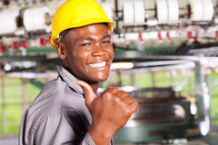 Textile worker thumb up. Happy african american textile worker thumb up in factory Stock Images
