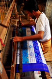 Textile worker weaving Pochampally clothes Stock Images