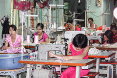 Textile workers in a small asian factory Royalty Free Stock Photography