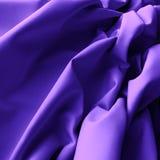 Textiler med veck för bakgrund Royaltyfri Bild
