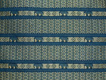 Textiles 03. Textile in blue and gold with Elephant motif Stock Photo