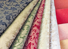 Textiles. Different in texture and composition of samples of material Stock Photos