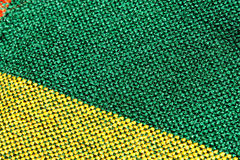 Textiles. Woven yellow and green fibers of a Mexican tablecloth in Macro Royalty Free Stock Image