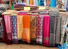 Textiles and Clothing at the bazaar. The Turkish market Royalty Free Stock Photos