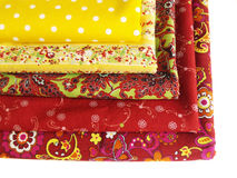 Textiles for fabric shop. Different cotton fabric for drapery department (on a white background Royalty Free Stock Photography