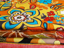 Textiles with print. Colored print textiles for sewing Stock Images