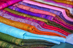 Textiles for sale, colored cloth. Laos. Luang Prabang - Laos, textiles for sale, colored cloth Royalty Free Stock Images