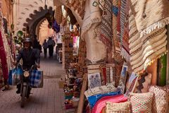 Textiles for sale at the street bazaar stall in Medina. stock photography