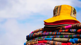 Textiles of South America. Hat and blankets with indigenous patterns of Peru Stock Images