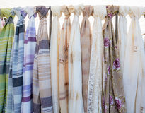 Textiles. Variety of textiles hanging from a rack Stock Photo
