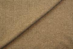 Textilgewebe-Hintergrundbeschaffenheit oder Muster von Kleidung Stockfoto