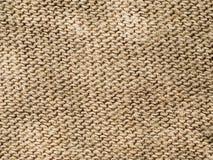 Textilhintergrund - brauner Baumwollstoff Stockbild