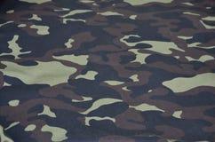 Textilmodell av militärt kamouflagetyg Royaltyfri Foto