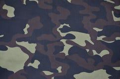 Textilmodell av militärt kamouflagetyg Arkivbild